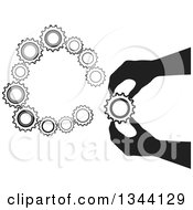 Clipart Of A Black Silhouetted Hand Inserting A Gear Cog Wheel 2 Royalty Free Vector Illustration by ColorMagic
