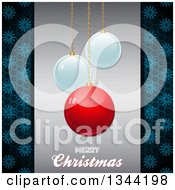 Clipart Of 3d Suspended Shiny Ornaments Over Merry Christmas Text On Metal With Snowflakes Royalty Free Vector Illustration