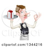Clipart Of A Cartoon Caucasian Male Waiter With A Curling Mustache Holding A Gift On A Platter And Gesturing Ok Royalty Free Vector Illustration