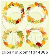 Clipart Of Colorful Autumn Leaf Wreaths Over Yellow Royalty Free Vector Illustration