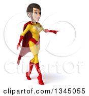 Clipart Of A 3d Brunette White Female Super Hero In A Yellow And Red Suit Walking And Pointing To The Right Royalty Free Illustration