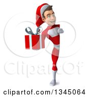 3d Full Length Young White Male Super Hero Santa Holding A Christmas Gift And Looking Around A Sign