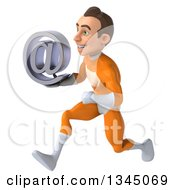 Clipart Of A 3d Young Brunette White Male Super Hero In An Orange Suit Sprinting To The Left And Holding An Email Arobase At Symbol Royalty Free Illustration