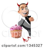 Clipart Of A 3d Young White Devil Businessman Holding A Pink Frosted Cupcake Around A Sign Royalty Free Illustration