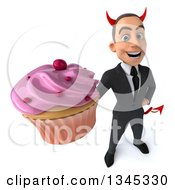 Clipart Of A 3d Young White Devil Businessman Holding Up A Pink Frosted Cupcake Royalty Free Illustration
