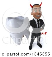 Clipart Of A 3d Young Black Devil Businessman Holding Up A Tooth Royalty Free Illustration