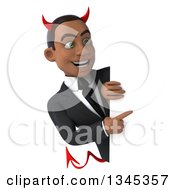 Clipart Of A 3d Young Black Devil Businessman Pointing Around A Sign Royalty Free Illustration
