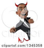 Clipart Of A 3d Young Black Devil Businessman Pointing Outwards Around A Sign Royalty Free Illustration