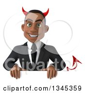Clipart Of A 3d Young Black Devil Businessman Over A Sign Royalty Free Illustration