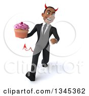 Clipart Of A 3d Young Black Devil Businessman Holding A Pink Frosted Cupcake And Speed Walking Royalty Free Illustration by Julos