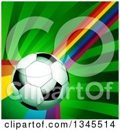 Clipart Of A 3d Shiny Soccer Ball Over A Curving Rainbow And Green Rays Royalty Free Vector Illustration