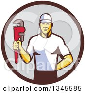 Clipart Of A Retro Caucasian Male Plumber Holding A Monkey Wrench In A Brown And Gray Circle Royalty Free Vector Illustration