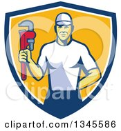 Clipart Of A Retro Caucasian Male Plumber Holding A Monkey Wrench In A Blue White And Yellow Shield Royalty Free Vector Illustration