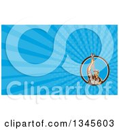 Clipart Of A Retro Male Mechanic Holding A Wrench Above His Head In A Circle And Blue Rays Background Or Business Card Design Royalty Free Illustration