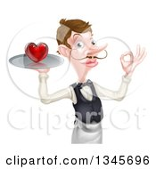 Cartoon Caucasian Male Waiter With A Curling Mustache Holding A Red Love Heart On A Tray And Gesturing Ok
