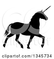 Clipart Of A Black Silhouetted Unicorn Horse Trotting Royalty Free Vector Illustration by AtStockIllustration