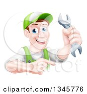 Clipart Of A Happy Middle Aged Brunette Caucasian Mechanic Man In Green Wearing A Baseball Cap Holding A Wrench And Pointing Royalty Free Vector Illustration