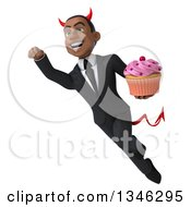 Clipart Of A 3d Young Black Devil Businessman Holding A Pink Frosted Cupcake And Flying Royalty Free Illustration