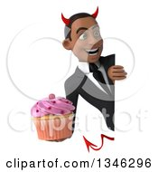 Clipart Of A 3d Young Black Devil Businessman Holding A Pink Frosted Cupcake And Looking Around A Sign Royalty Free Illustration