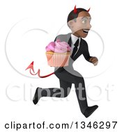 Clipart Of A 3d Young Black Devil Businessman Holding A Pink Frosted Cupcake And Sprinting To The Right Royalty Free Illustration