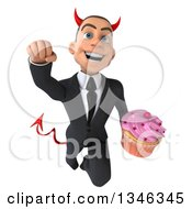 Clipart Of A 3d Young White Devil Businessman Holding A Pink Frosted Cupcake And Flying Royalty Free Illustration