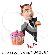 Clipart Of A 3d Young White Devil Businessman Holding A Pink Frosted Cupcake And Looking Around A Sign Royalty Free Illustration