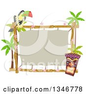 Toucan Bird Perched On A Topical Sign With A Tiki Statue And Palm Trees
