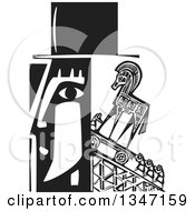 Black And White Woodcut Mans Profiled Head With People Pushing A Trojan Horse Up A Ramp