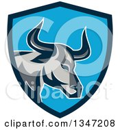 Clipart Of A Retro Texas Longhorn Steer Bull In A Blue Shield Royalty Free Vector Illustration