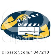 Hands Holding A Clapperboard In A Navy Blue Oval