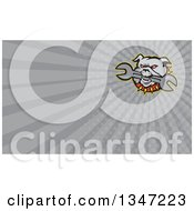 Clipart Of A Cartoon Evil Bulldog Bititing A Spanner Wrench And Gray Rays Background Or Business Card Design Royalty Free Illustration