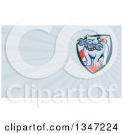 Clipart Of A Cartoon Evil Bulldog Bititing A Spanner Wrench In A Shield And Pastel Blue Rays Background Or Business Card Design Royalty Free Illustration