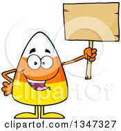 Clipart Of A Cartoon Halloween Candy Corn Character Holding Up A Blank Wood Sign Royalty Free Vector Illustration
