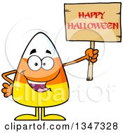 Clipart Of A Cartoon Candy Corn Character Holding Up A Happy Halloween Greeting Wooden Sign Royalty Free Vector Illustration