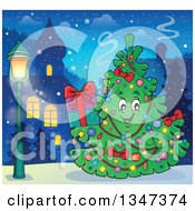 Clipart Of A Cartoon Christmas Tree Character Holding A Present Outdoors In A Town Royalty Free Vector Illustration