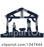 Clipart Of A Navy Blue Silhouetted Mary And Joseph Praying Over Baby Jesus In A Manger Royalty Free Vector Illustration