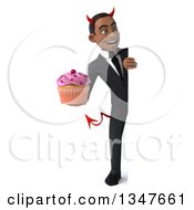 Clipart Of A 3d Full Length Young Black Devil Businessman Holding A Cupcake Around A Sign Royalty Free Illustration