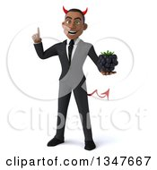 Clipart Of A 3d Young Black Devil Businessman Holding Up A Finger And A Blackberry Royalty Free Illustration