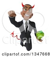 Clipart Of A 3d Young Black Devil Businessman Holding A Green Bell Pepper And Flying Royalty Free Illustration