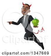 Clipart Of A 3d Young Black Devil Businessman Holding A Green Bell Pepper Pointing And Flying Royalty Free Illustration