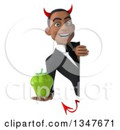 Clipart Of A 3d Young Black Devil Businessman Holding A Green Bell Pepper Around A Sign Royalty Free Illustration