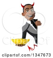 Clipart Of A 3d Young Black Devil Businessman Holding A Banana Around A Sign Royalty Free Illustration