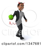 Clipart Of A 3d Young Black Devil Businessman Holding A Green Apple And Walking Slightly To The Right Royalty Free Illustration