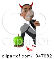 Clipart Of A 3d Young Black Devil Businessman Holding A Green Apple Around A Sign Royalty Free Illustration