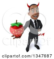 Clipart Of A 3d Young Black Devil Businessman Holding Up A Strawberry Royalty Free Illustration