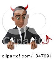 Clipart Of A 3d Young Black Devil Businessman Looking Down Over A Sign Royalty Free Illustration