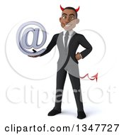 Clipart Of A 3d Young Black Devil Businessman Holding An Email Arobase At Symbol Royalty Free Illustration