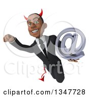 Clipart Of A 3d Young Black Devil Businessman Holding An Email Arobase At Symbol And Flying Royalty Free Illustration