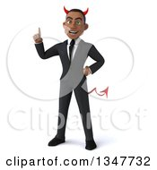 Clipart Of A 3d Young Black Devil Businessman Holding Up A Finger Royalty Free Illustration by Julos