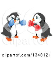 Clipart Of Cute Penguin Fighters Boxing Royalty Free Vector Illustration